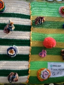 Yarnbomb railing close up