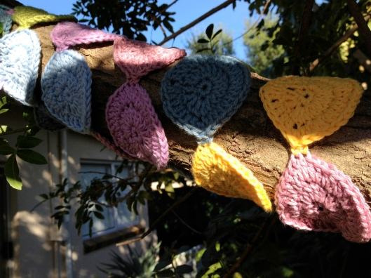 Tree yarnbomb with crochet circles