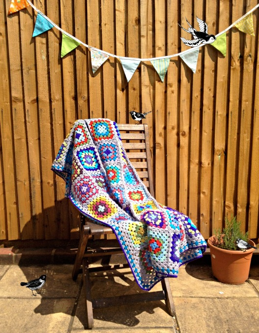 granny square blanket with birds