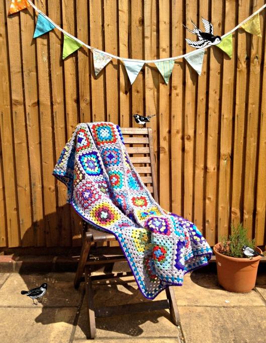 granny square blanket with birds