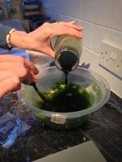 Adding dye liquid to water and salt mixture