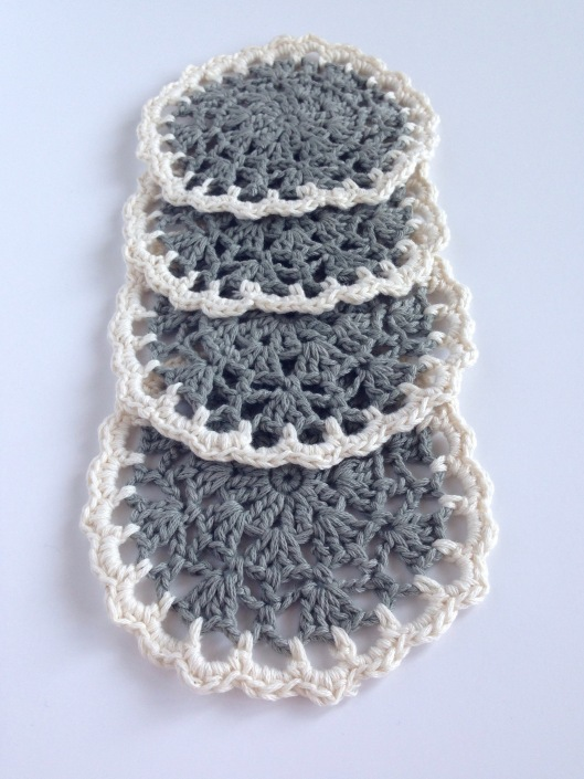 grey and white crochet coasters