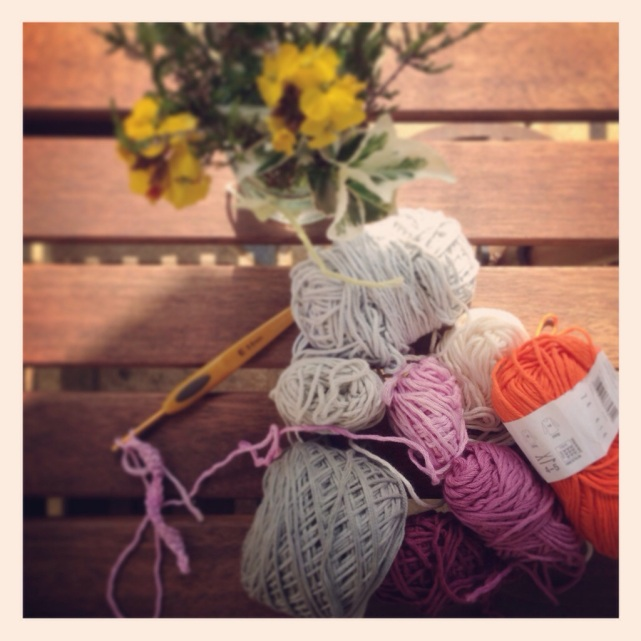 yarn and flowers on patio table