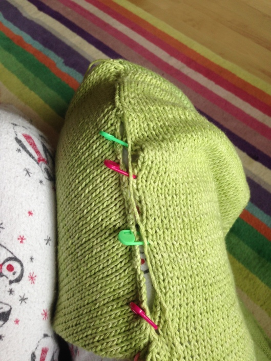 Sewing the sleeve into body of knitting