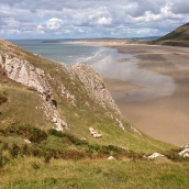 Rhossili Bay - do you see the sheep grazing on the cliff?