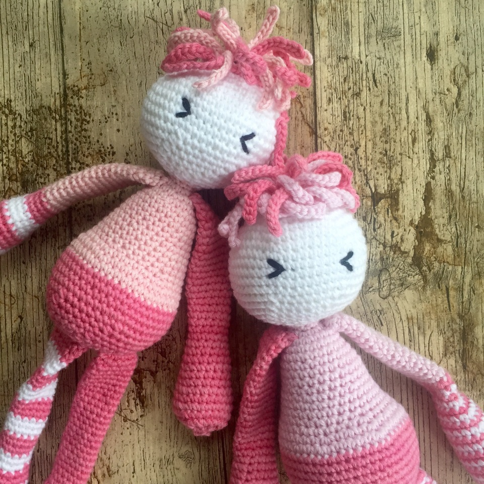 Pink and white amigurimi crochet dolls