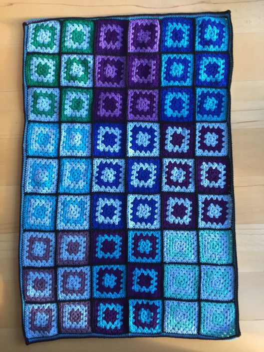 blue and black granny square blanket